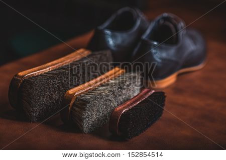 selective focus on equipment for a shoe shine with a pair of shoes, close up