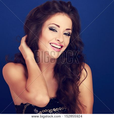 Beautiful Laughing Makeup Woman With Long Volume Hairdo On Bright Blue Background Looking Happy. Clo