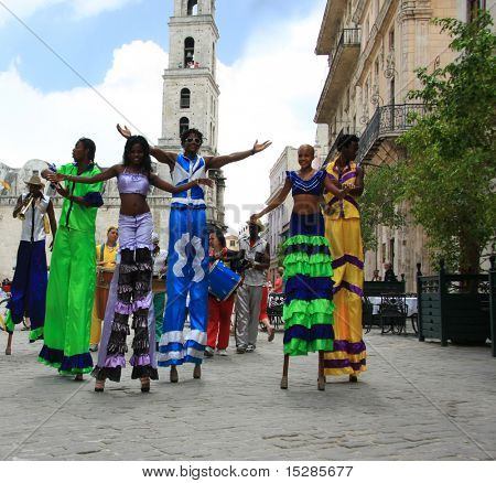 HAVANA - CIRCA NOVEMBER 2010 : Colorful Cuban girls dance on stilts and entertain tourists circa November 2010 in Havana.