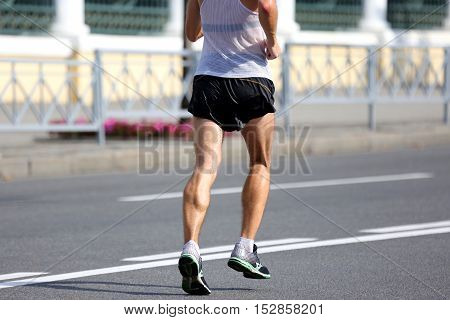feet running athlete at the distance of a marathon