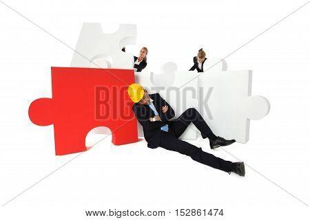 Coworkers look at tired foreman sleeping near puzzle isolated on white background