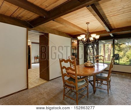 Interior Of Dining Room In Large Wooden House