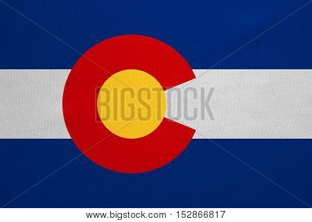 Flag of the US state of Colorado. American patriotic element. USA banner. United States of America symbol. Colorado official flag with real detailed fabric texture illustration. Accurate size colors