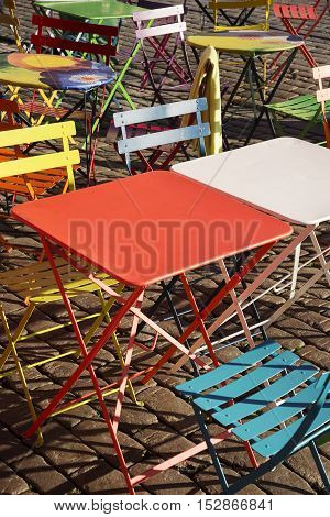 colourful modern trendy tables and chairs at street cafe in helsinki finland