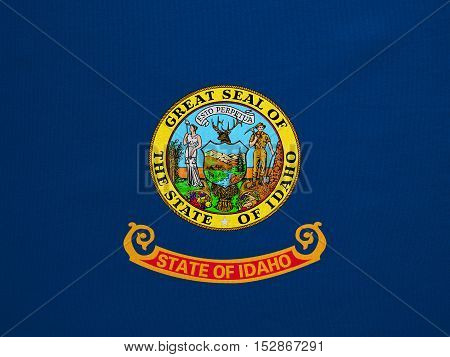 Flag of the US state of Idaho. American patriotic element. USA banner. United States of America symbol. Idahoan official flag with real detailed fabric texture illustration. Accurate size colors