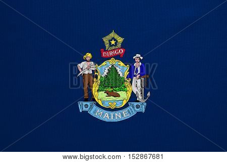 Flag of the US state of Maine. American patriotic element. USA banner. United States of America symbol. Mainer official flag with real detailed fabric texture illustration. Accurate size colors