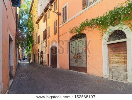 old town italian street in Trastevere, Rome, Italy