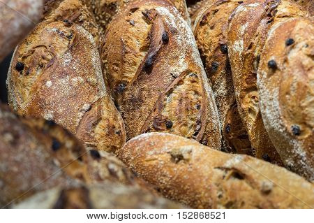 Raisins Bread And Group Of Baked Goods For Sale At Farmers Market