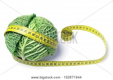 Cabbage and measuring tape on white background
