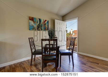View of dining area with modern table and chair set hardwood floor and light walls. Northwest USA