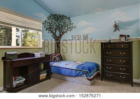 Kid's Bedroom With Blue Sky Painted Walls