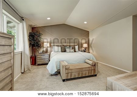 Elegant Beige Bedroom Interior With Pale Blue Bedding