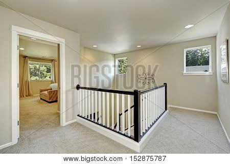 Bright Beige Hallway With Carpet Floor And Stairacse