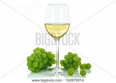 Ripe grapes and wine glass isolated on white