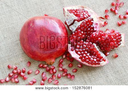 close up from pomegranate on sackcloth background