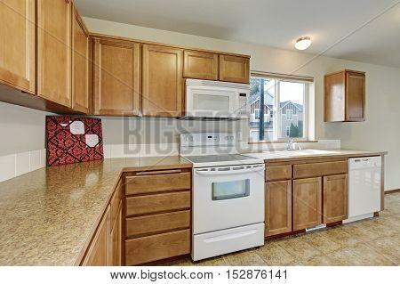 Wooden Kitchen Storage Combination And White Appliances