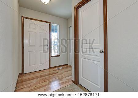 White Walls Hallway Interior With Hardwood Floor