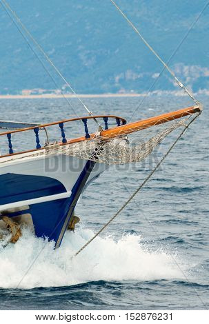 Sailing boat front view in the sea
