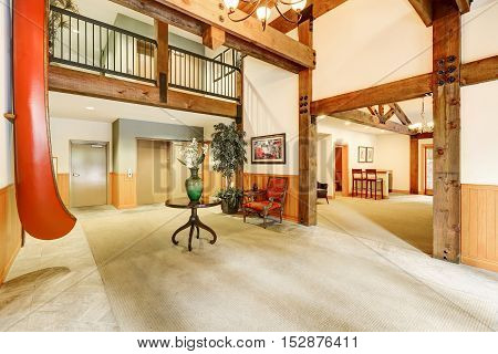 Lobby area in apartment complex . Bright spacious room with high ceiling and wooden beams. Northwest USA