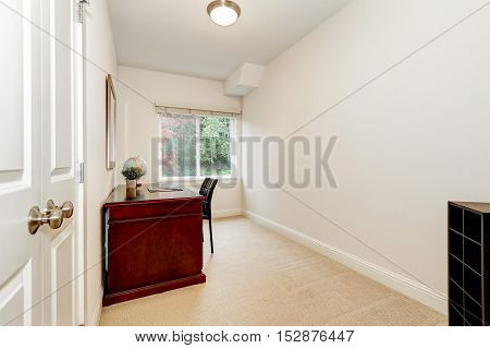 White Interior Of Home Office With Burgundy Desk
