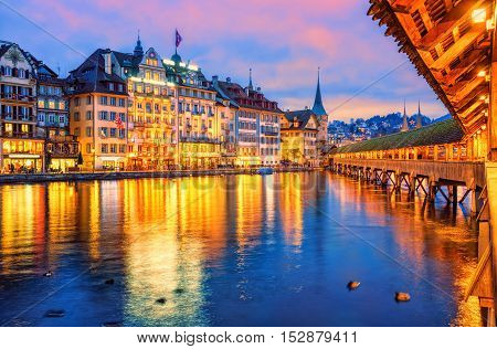 Lucerne Switzerland view of the old town from wooden Chapel bridge in the evening
