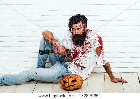 Zombie Man With Halloween Pumpkin
