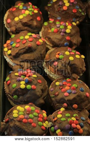 Fresh made confectionery chocolate with multicolored sprinkles