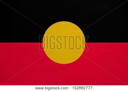 Australian Aboriginal official flag. Commonwealth of Australia patriotic symbol banner element background. Australian Aboriginal flag detailed fabric texture accurate size colors illustration