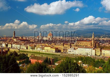 View of the beautiful medieval italian city and culture capital - Florence with cathedrals and bridges over river and blue cloudy sky. Travel outdoor sightseeing historical background.