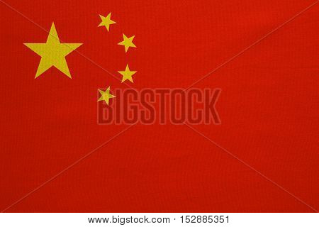 Chinese national flag. Symbol of the People's Republic of China. Patriotic PRC background design. Correct colors. Flag of China with real detailed fabric texture accurate size illustration