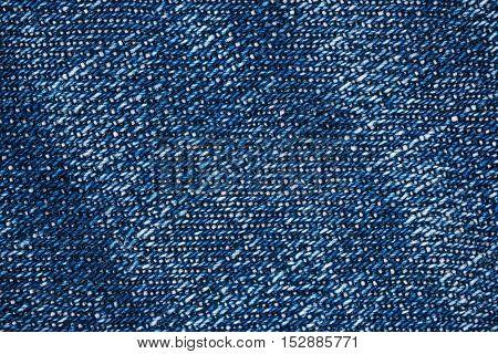Macro flat view of blue denim jeans fabric