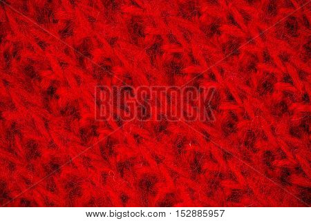 Macro flat view of knitted surface in red ribs