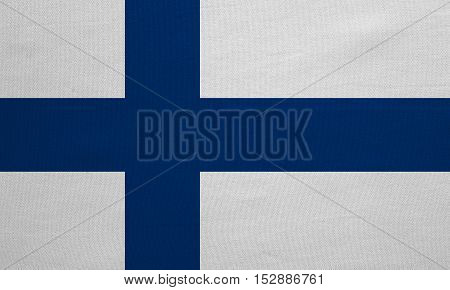 Finnish national official flag. Patriotic symbol banner element background. Correct colors. Flag of Finland with real detailed fabric texture accurate size illustration