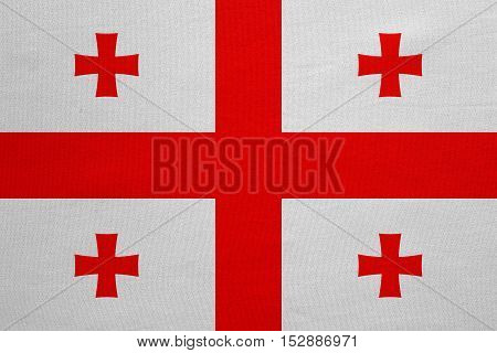 Georgian national official flag. Patriotic symbol banner element background. Correct colors. Flag of Georgia with real detailed fabric texture accurate size illustration