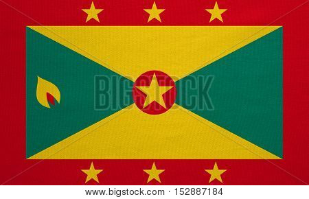 Grenadian national official flag. Patriotic symbol banner element background. Correct colors. Flag of Grenada with real detailed fabric texture accurate size illustration