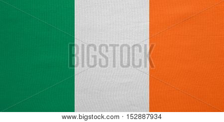 Irish national official flag. Patriotic symbol banner element background. Correct colors. Flag of Ireland with real detailed fabric texture accurate size illustration