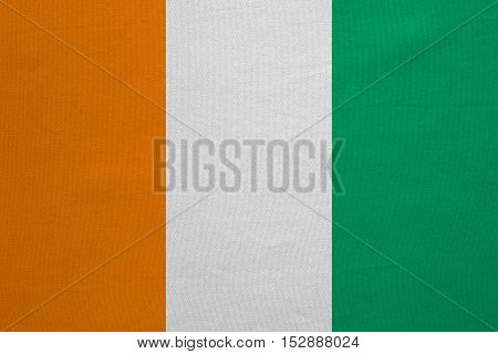 Cote D Ivoire national official flag. African patriotic symbol banner element background. Correct colors. Flag of Ivory Coast with real detailed fabric texture accurate size illustration