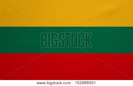 Lithuanian national official flag. Patriotic symbol banner element background. Correct colors. Flag of Lithuania with real detailed fabric texture accurate size illustration