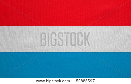 Luxembourgish national official flag. Patriotic symbol banner element background. Correct colors. Flag of Luxembourg with real detailed fabric texture accurate size illustration