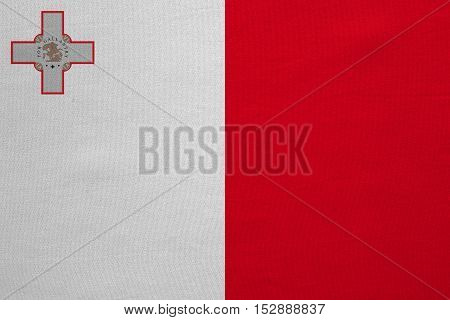Maltese national official flag. Patriotic symbol banner element background. Correct colors. Flag of Malta with real detailed fabric texture accurate size illustration