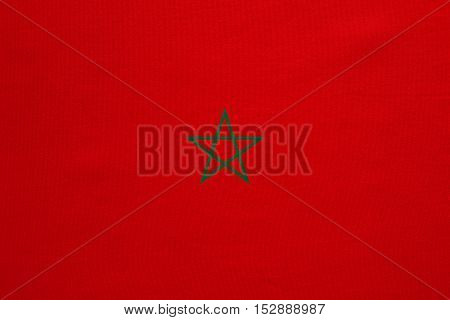 Moroccan national official flag. African patriotic symbol banner element background. Correct colors. Flag of Morocco with real detailed fabric texture accurate size illustration