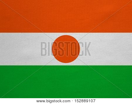Nigerien national official flag. African patriotic symbol banner element background. Correct colors. Flag of Niger with real detailed fabric texture accurate size illustration