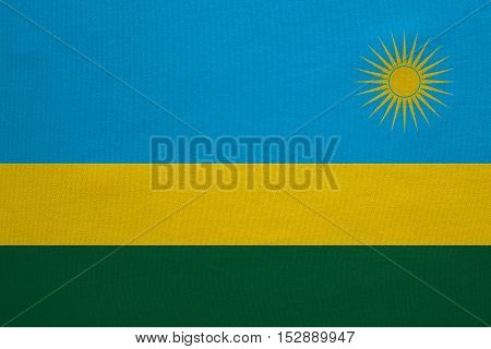 Rwandan national official flag. African patriotic symbol banner element background. Correct colors. Flag of Rwanda with real detailed fabric texture accurate size illustration
