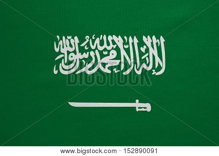 Saudi Arabian national official flag. Patriotic symbol banner element background. Correct colors. Flag of Saudi Arabia with real detailed fabric texture accurate size illustration