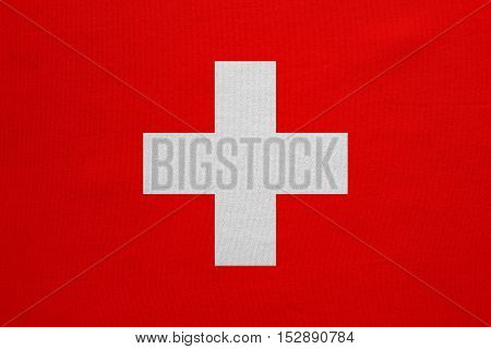 Swiss national official flag. Patriotic symbol banner element background. Correct colors. Flag of Switzerland with real detailed fabric texture accurate size illustration