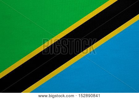 Tanzanian national official flag. African patriotic symbol banner element background. Correct colors. Flag of Tanzania with real detailed fabric texture accurate size illustration