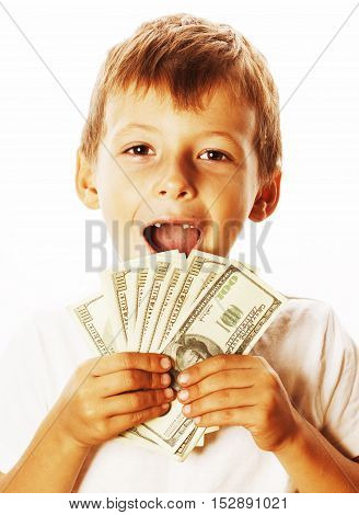 young cute boy holding lot of cash, american dollars isolated on white background