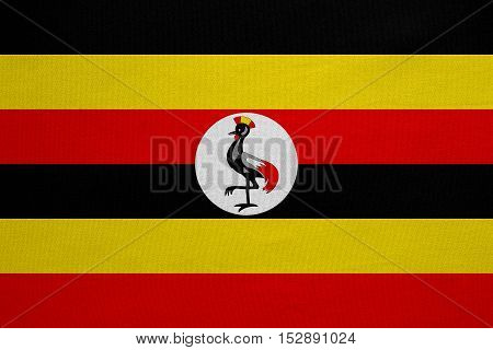 Ugandan national official flag. African patriotic symbol banner element background. Correct colors. Flag of Uganda with real detailed fabric texture accurate size illustration