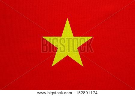 Vietnamese national official flag. Patriotic symbol banner element background. Correct colors. Flag of Vietnam with real detailed fabric texture accurate size illustration