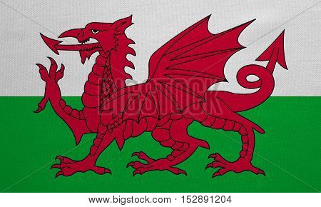 Welsh national official flag. Patriotic symbol banner element background. Correct colors. Flag of Wales with real detailed fabric texture accurate size illustration